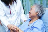 Doctor Holding Touching Hands Asian Senior Or Elderly Old Lady Woman Patient With Love, Care, Helpin poster