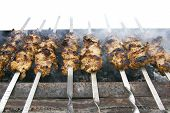Meat Kebabs On Grill Isolated Over White