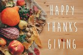 Happy Thanksgiving Text On Pumpkin,vegetables ,colorful Leaves With Acorns And Nuts On Wooden Table. poster