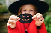 Young playful girl enjoying the Halloween festival poster