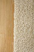 Rug on hardwood oak parquet floor