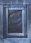 A frame made of different shades of blue denim