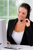 Pretty Young Woman Working As A Call Center Representative