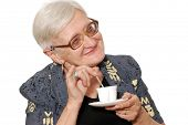 Portrait of the old woman with a coffee cup on a light background Portrait of the old woman with a coffee cup on a light background