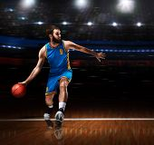Basketball Player In Action On Basketball Playground poster
