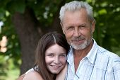 stock photo of father daughter  - Portrait happy the grandfather and granddaughter outdoor - JPG