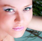 Portrait of a cute brunette with blue eyes , studio shot