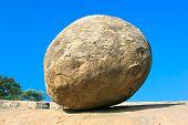 Conceptual image of a balancing butter ball rock in Mahabalipuram,Tamil Nadu,  India