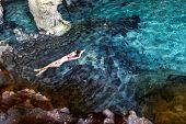 A beautiful hispanic brunette model enjoying a swim in a local cenote near Yucatan, Mexico. poster