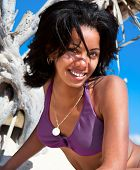 Beautiful caribbean  woman on tropical beach, close up
