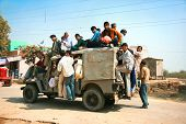 AGRA, INDIA - FEBRUARY 22:  Public transport in India .Crazy road scene -truck with many people.   F