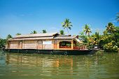 Exciting journey with a houseboat through the backwaters in Kerala, India