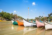 Wooden outrigger fishing boats  on delta of  Baga river at Calangute beach, Goa, India