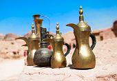 Typical vintage metal teapots in bedouin cafe in Petra, Jordan