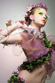 stock photo of beautiful woman  - Young beautiful woman dressed as Spring - JPG