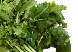 stock photo of turnip greens  - Bunch of vibrant green turnip greens packed with vitamins and minerals - JPG