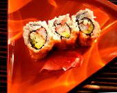 Sushi On Plate With Dappled Light