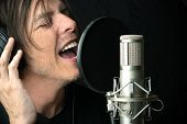 Man Sings Into Condenser Microphone