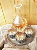 Glass  Decanter Wint Three Melchior Cups Isolated On White