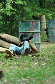 foto of gun shot wound  - Picture of man hiding from the enemy in paintball game - JPG