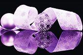 purple christmas balls and beautiful ribbon