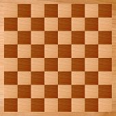 stock photo of draught-board  - Wooden chessboard with light and dark wood checkers - JPG