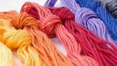 Several Colorful Buns Of Threads