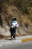 Indigenous Woman Carrying a Child
