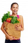 Portrait of woman with groceries shopping bag full of healthy vegetables smiling