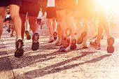 stock photo of crowd  - Marathon running race people competing in fitness and healthy active lifestyle feet on road - JPG