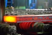 foto of furnace  - hot steel on conveyor; sheet metal in plant