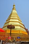 Golden Pagoda Under Clear Sky Of Thailand