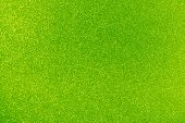 Background filled with shiny lime green glitter