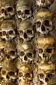 Wall full of skulls and bones in the bone chapel in Evora, Portugal