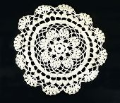 image of doilies  - Vintage hand made embroidered doily on black background - JPG