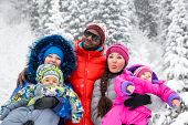 Happy Family With Children In Ski Suit In Snowy Winter Outdoors, Almaty, Kazakhstan