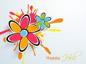 Indian color festival Holi celebration concept with colourful flowers on color splash background.