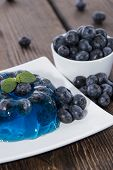 stock photo of jello  - Blueberry Jello with fresh fruits on a small plate - JPG