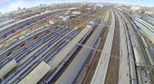 Many trains on railways of railway station. View from unmanned quadrocopter
