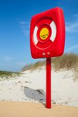 Safety Life Buoy In Red Case Stand On The Beach