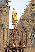 Golden statue in front of dutch parliament - The Hague - Neherlands