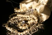 pic of pompous  - bag spilled over with jewels falling out - JPG