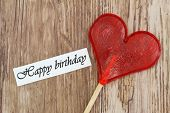 Happy Birthday card with heart shaped lollipop