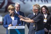 BERLIN, GERMANY - MAY 20, 2014: German Chancellor Angela Merkel (L) open up the International aviation and space exhibition ILA-2014.