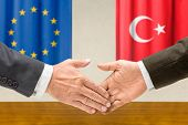 Representatives of the EU and Turkey shake hands