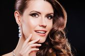 close up portrait brunette woman with luxury accessories.