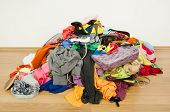 stock photo of untidiness  - Untidy cluttered woman wardrobe all on the floor - JPG