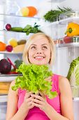 woman green salad think look up, refrigerator