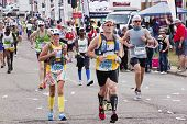Colorful Runners Participate In Comrades Marathon