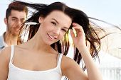 picture of windswept  - Beautiful young girl smiling at summertime - JPG